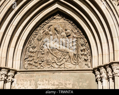 Relief of the Door of piety. Cathedral Of The Holy Cross And Saint Eulalia In Barcelona, Catalonia. North of Spain - Stock Image