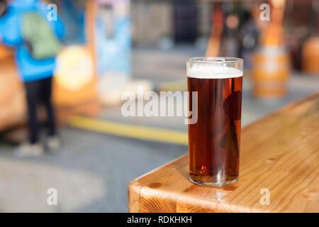 Drinking an 'altbier' (old beer in german) in Dusseldorf's old town, Germany. - Stock Image