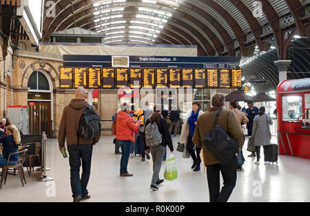 Arrival and departure train information sign boards at the station York North Yorkshire England UK United Kingdom GB Great Britain - Stock Image