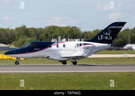 Honda HA-420 light executive business jet, registration LX-WJA, taking off from Manchester Airport, England. - Stock Image