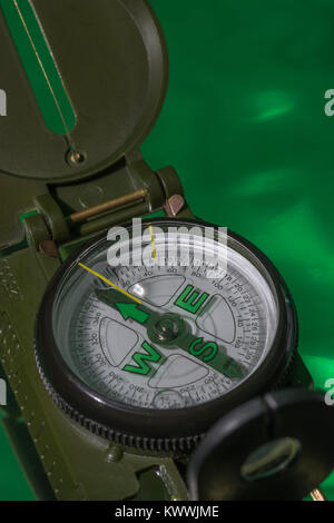 Macro-photo of compass rose face with needle. North direction,  Outward Bound. - Stock Image