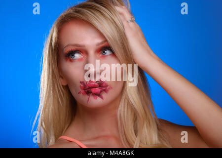 Pretty, blonde, young woman with crazy make-up © Jeremy Graham-Cumming - Stock Image