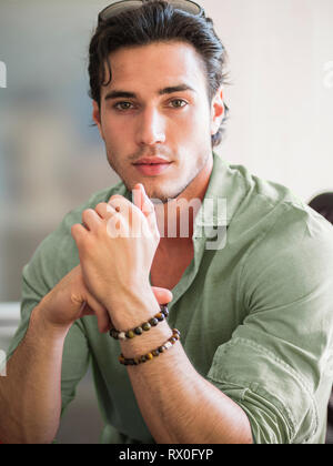 Attractive young man indoors wearing a shirt - Stock Image