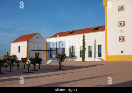 The courtyard of the Medieval farmhouse and chapel of the Torre de Palma Winery and hotel - Stock Image