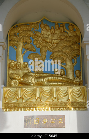 One of the Four Statues in the London Peace Pagoda, Battersea Embankment, West London, UK. - Stock Image