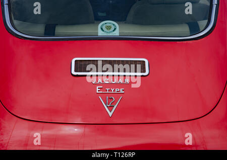 Back of a red E Type Jaguar V12 Coupe. - Stock Image