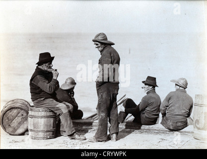Fishermen on Wharf, ca 1885, by Frank Meadow Sutcliffe - Stock Image