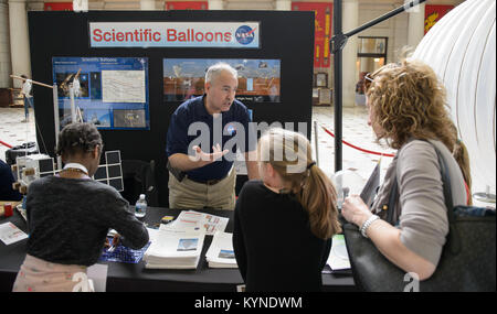 Visitors explore one of NASA's exhibits at the Earth Day event on Thursday, April 20, 2017 at Union Station - Stock Image
