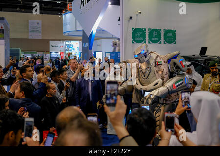 February 18, 2019 - Abu Dhabi, UAE: People taking pictures with TITAN - The Greeting Robot - Stock Image