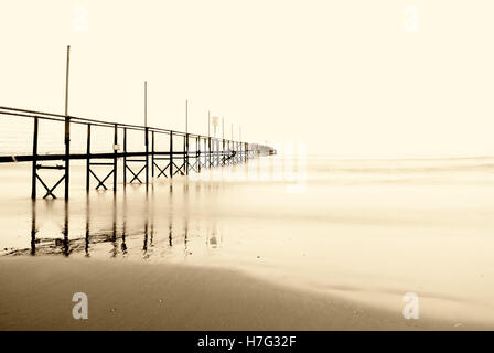 isolated footbrige in the sea in autumn - Stock Image