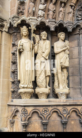 Religious statues in the doorway of the Basilica in Trier - Stock Image