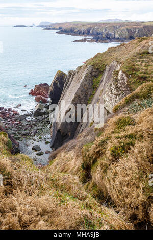 Moody coastline of Pembrokshire, Wales, seen from coast path. - Stock Image