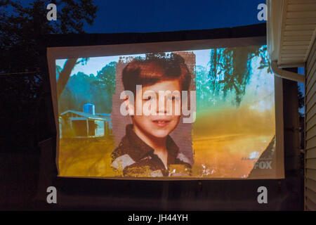 Merrick, New York, USA. 11th June 2017.  Picture of young boy shown on large screen is 'American Grit' TV - Stock Image