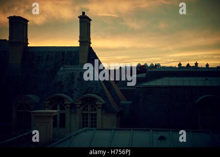Rooftops residential buildings in Paris at dusk. - Stock Image