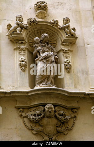 Arles; Bouches du Rhone, France; Small statue of Madonna and child on a street corner - Stock Image