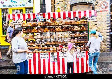 Donuts and cronuts stall, donuts, cronuts, doughnut stall, doughnut seller, doughnut selection, selling donuts, - Stock Image