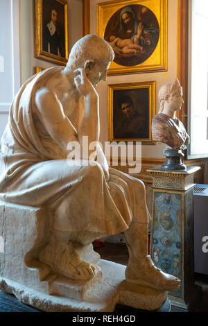Italy Rome Galleria Spada Gallery Palazzo statue of Greek philosopher, Aristotle in a sitting thinking pose - Stock Image