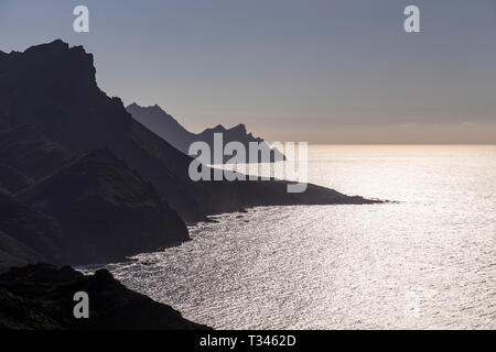 High sea cliffs in silhouette at Tamadaba on the Atlantic coast of Gran Canaria, Canary Islands - Stock Image