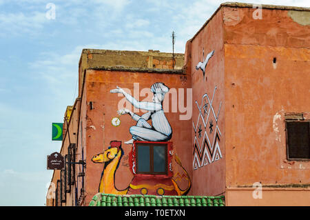 Painted wall in the Medina of Marrakech, Morocco - Stock Image