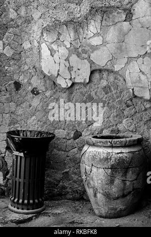 Ercolano ruins, Italy. Waste bin near ancient jar - Stock Image