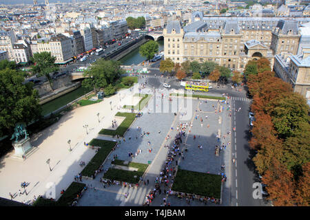 Shadow of the towers of Notre Dame de Paris towers on the parvis with people waiting in line, France - Stock Image