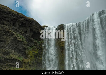 Waterfall and rough rock - Stock Image
