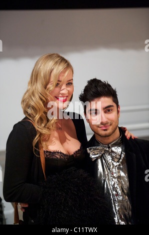 MTV presenter Laura Whitmore poses with a fan following the PPQ autumn 2011 collection at the BFC Showspace at Somerset - Stock Image