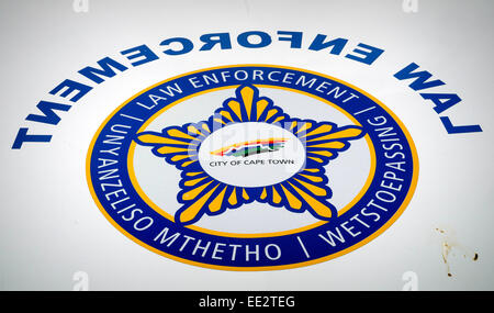 City of Cape Town logo and 'Law Enforcement' sign (also mirrored), on a vehicle in central Cape Town,. South - Stock Image