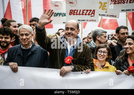 Nicola Zingaretti, President of Italy's Lazio region and new leader of the centre-left Democratic party PD (C), waves prior to Italy's Liberation Day celebrations in Milan, Italy  on 25th April 2019. The Festa della liberazione, also known as Anniversary of the Liberation is a national Italian holiday celebrating the end of the Nazi occupation during World War II and the victory of the Resistance. - Stock Image