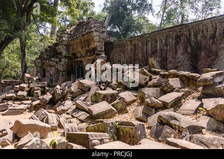 Parts lie in ruins at the Unesco World Heritage site of Ankor Thom, Siem Reap, Cambodia - Stock Image