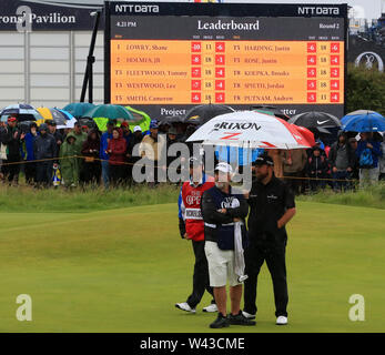 19th July, Portrush, Country Antrim, Northern Ireland; The 148th Open Golf Championship, Royal Portrush, Round Two ; Shane Lowry (IRE) in front of the leaderboard on the 13th green - Stock Image