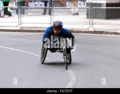 Wheelchair athlete Moatez 'Mo' Jomni  competing for Great Britain, in the 2019 London Marathon. He went on to finish  24th, in a time of 01:54:15. - Stock Image