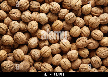 Fresh whole walnuts, filling the picture. Background of walnuts texture. - Stock Image