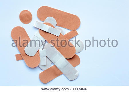 Assortment of plasters on a white background - Stock Image
