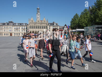 School teacher and pupils stundents marching on Victory In Europe VE day 8th May 2018 in Place de l'Hotel de Ville St Quentin, Aisne, France. - Stock Image