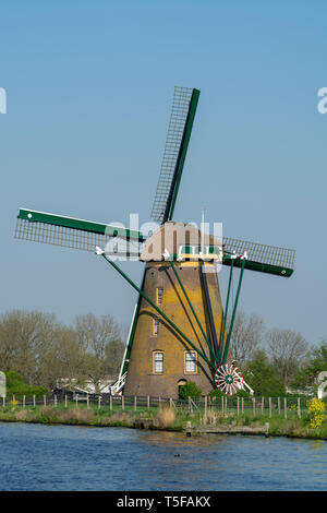 Waterways of North Holland and view on traditional Dutch wind mill, Dutch lifestyle landscape - Stock Image