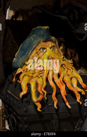 Replica Rubber Mask of Davey Jones from pirates of the Caribbean on a treasure chest - Stock Image
