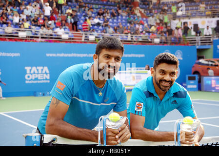 Pune, India. 5th January 2019. Rohan Bopanna and Divij Sharan, both of India, pose with their doubles championship trophies won at Tata Open Maharashtra ATP Tennis tournament in Pune, India. Credit: Karunesh Johri/Alamy Live News - Stock Image