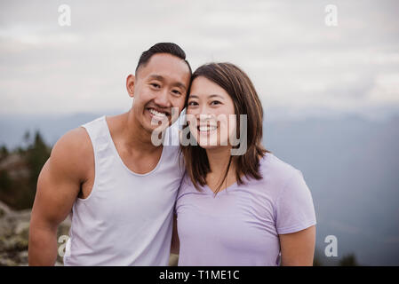 Portrait happy couple hiking - Stock Image