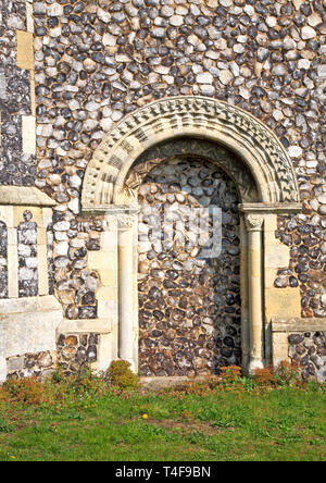 A view of the blocked southern doorway with Norman arch at the parish Church of St Botolph at Limpenhoe, Norfolk, England, United Kingdom, Europe. - Stock Image
