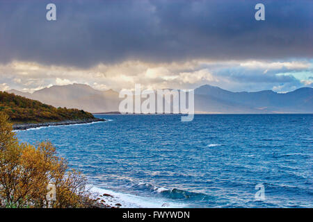Rain shower over island Andøya in northern Norway seen from Nupen near Harstad on island Hinnøya. - Stock Image