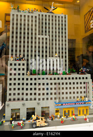 Manhattan, New York, U.S. - May 21, 2014 - In Rockefeller Center, the Lego store has Lego Miniland with a recreation of Radio City Music Hall in its window display, in Manhattan. The buildings are made from Lego building blocks. - Stock Image