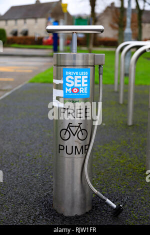 Kerbside free bicycle tyre air pump, Coniston, Lake District, Cumbria, England - Stock Image