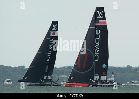 Portsmouth, UK. 23rd July 2015. Oracle Team USA and Softbank Team Japan in a practice start during the Parade of - Stock Image