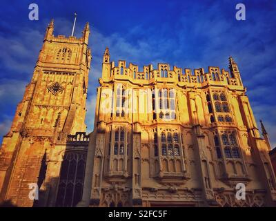 A view of the Bell Tower and Ancient Town Hall that form the exterior view of St. John Baptist Church in the Roman City of Cirencester, Gloucestershire, England. Photo Credit - © COLIN HOSKINS. - Stock Image