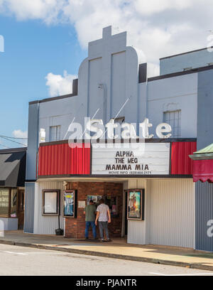 NEWTON, NC, USA-9/2/18: An old movie theater in a small, southern town, with two men buying tickets. - Stock Image