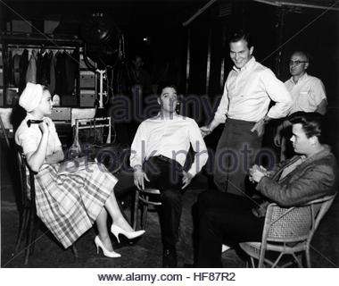 G.I. BLUES (1960) - Behind the scenes shot of (L-R) Juliet Prowse, Elvis Presley and Pat Boone on set. Editorial - Stock Image