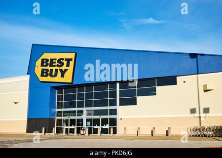 Best Buy front exterior entrance to the consumer electronics big box retail store with the corporate logo sign in Montgomery Alabama USA. - Stock Image