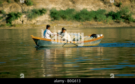 Two Indian Boys in a Rowing Boat, Lake Pichola, Rajasthan, India - Stock Image