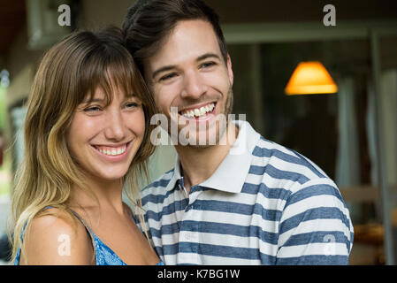 Young couple smiling together, portrait - Stock Image